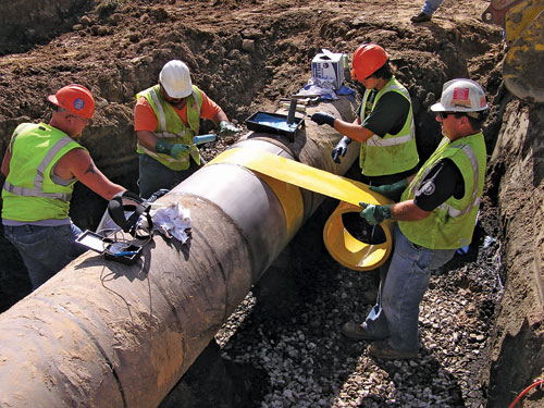 COIL PASS INSTALLATION METHOD During this typical installation method, the coil of composite material is passed between two installers on either side of the pipe.