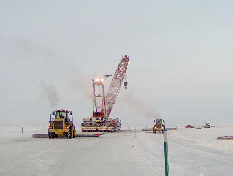 CH2M AlaskaEnergy & Chemicals lays a mat road for acrane move on Alaska's North Slope, where the company provides support services to oil and gas companies for drilling and well work.